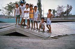 School kids on top school house after a lahar , USGS