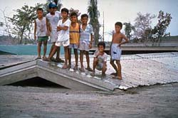 School kids on top school house after a lahar , USGS